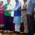 Miss. Pragati Shrinivas Jaju Receiving the Best Student Award at Secondary Level By the hands of Hon. Prakash Javadekar, Minister of State for Environment, Govt. of India. 1