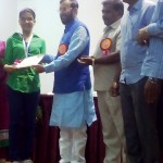 Miss. Pragati Shrinivas Jaju Receiving the Best Student Award at Secondary Level By the hands of Hon. Prakash Javadekar, Minister of State for Environment, Govt. of India. 2